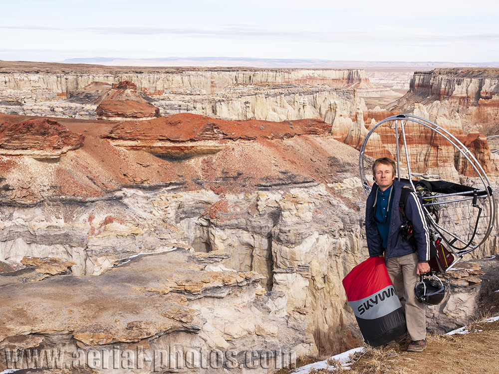 The photographer with his amazing portable aircraft on the rim of Coal Mine Canyon. Navajo & Hopi Reservations boundary, Arizona, USA.
