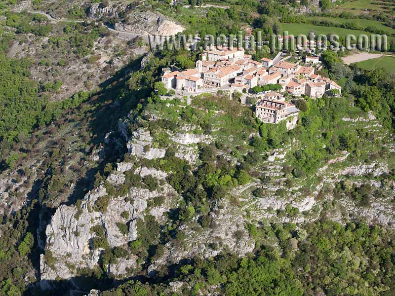 AERIAL VIEW photo of an hilltop town, Gourdon, French Riviera, France. VUE AERIENNE village médiéval perché, Côte d'Azur.