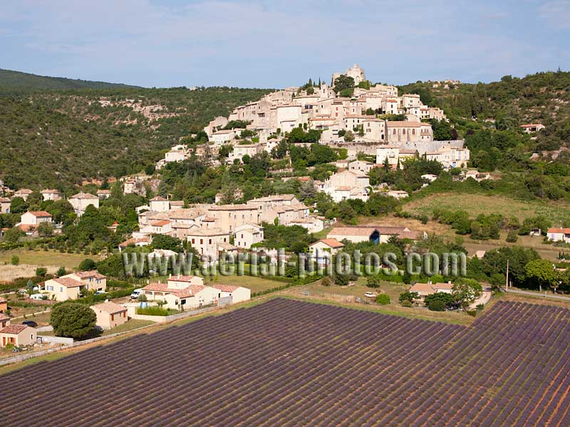 AERIAL VIEW photo of an hilltop town, Simiane-la-Rotonde, Provence, France. VUE AERIENNE village perché.