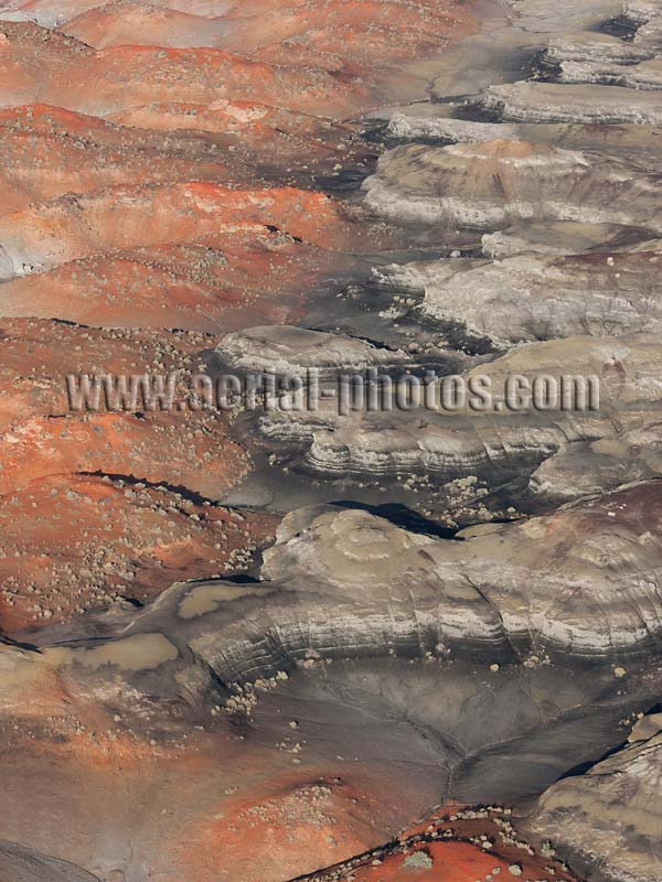 Aerial view of black and red mounds, badlands at Bisti De-Na-Zin Wilderness, New Mexico, United States.