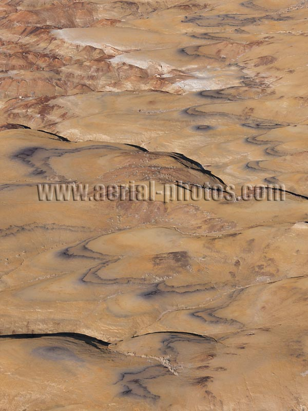 Aerial view of a coal seam in badlands, Bisti De-Na-Zin Wilderness, New Mexico, United States.