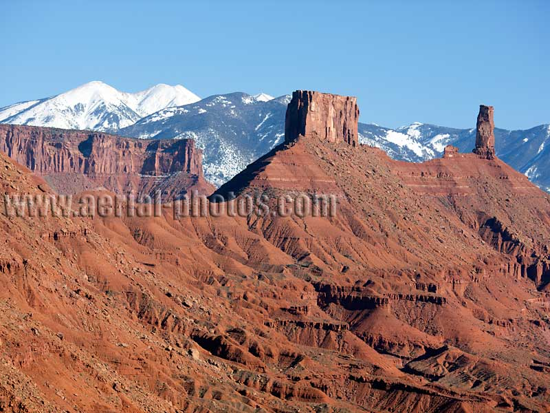 Aerial view of Castleton Tower and La Sal Mountains, Castle Valley, Utah, USA.