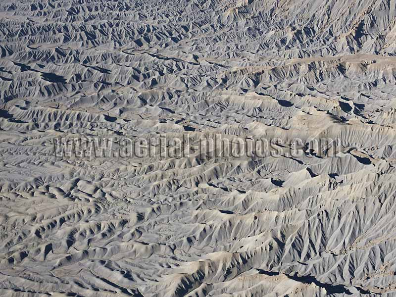 AERIAL VIEW photo of a desertic landscape, badlands near Caineville, Utah, United States.